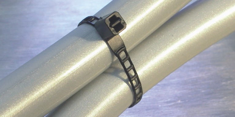 1973 Ladder Cable Tie securing tubes