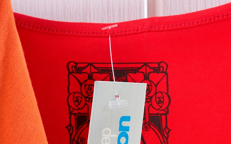 Swiftach Retail Clothing Tag on Red Shirt