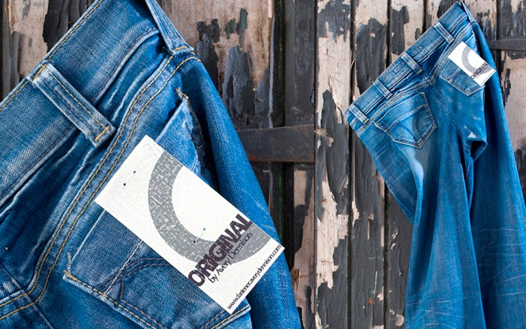 Plastic Staple Tag attached to denim jeans