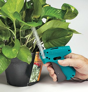 Horticultural Tool attaching tag to potted plant